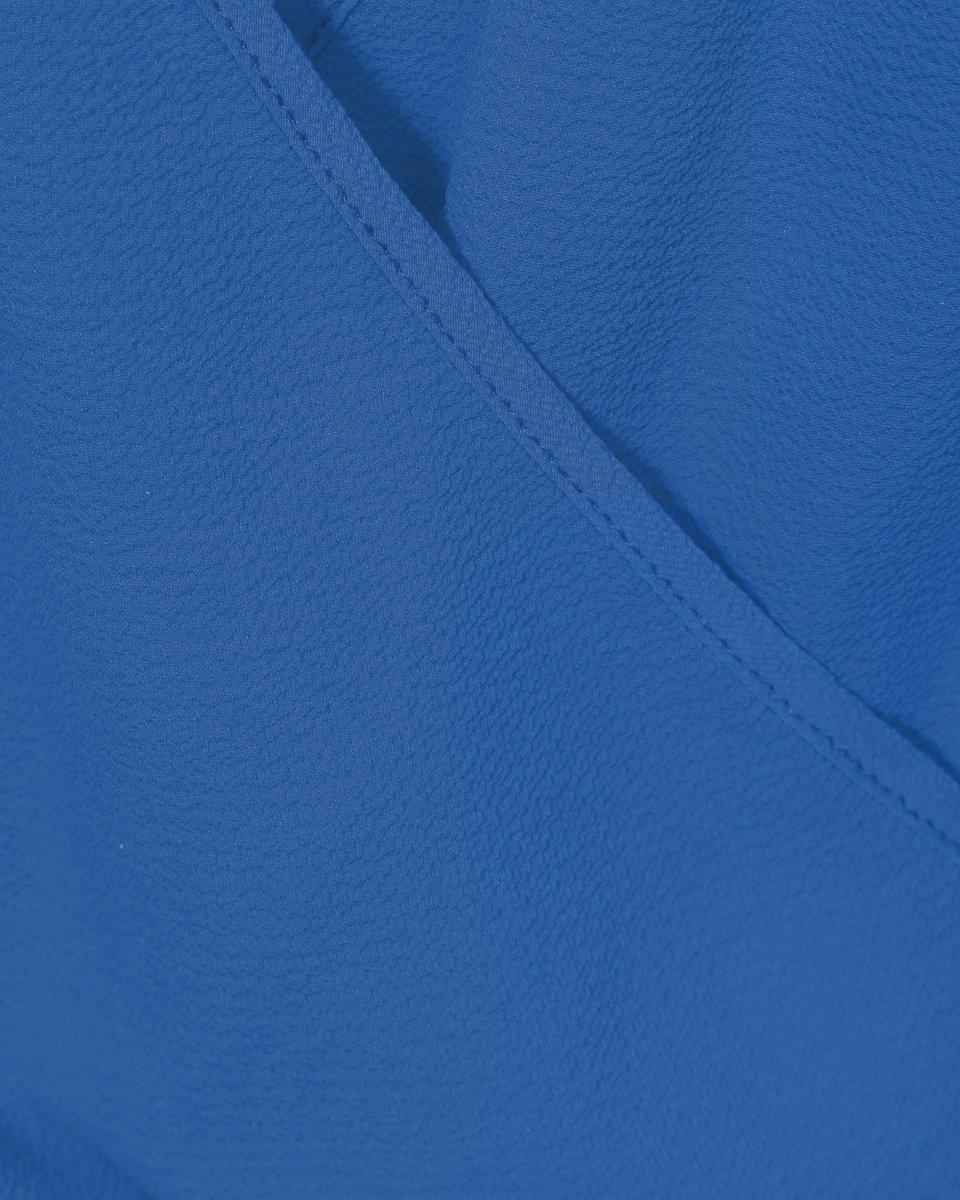 Брючный комбинезон с гофре голубого цвета