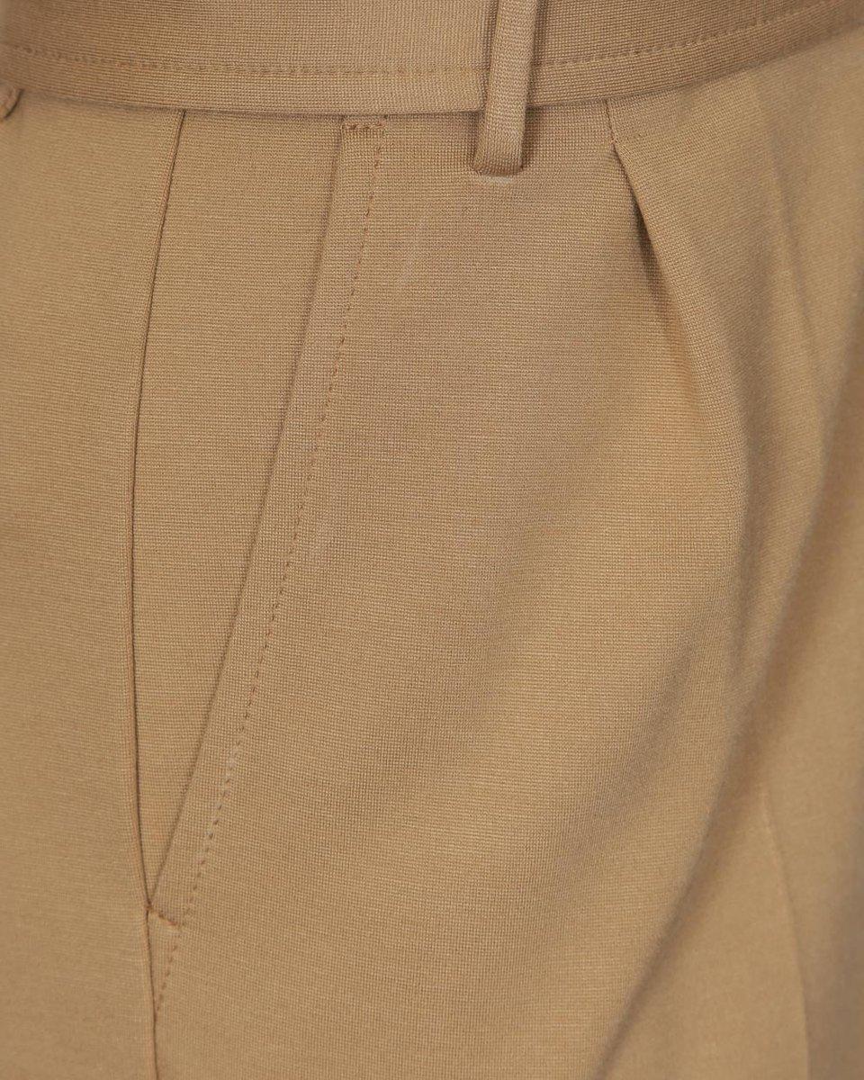 Комбинезон из трикотажа бежевого цвета с лацканами