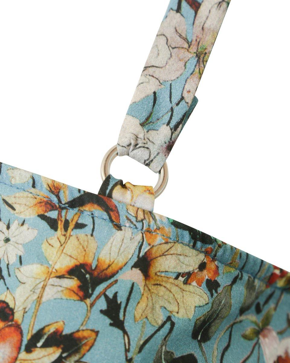 Платье асимметричного кроя с открытым плечом голубого цвета с цветочным рисунком