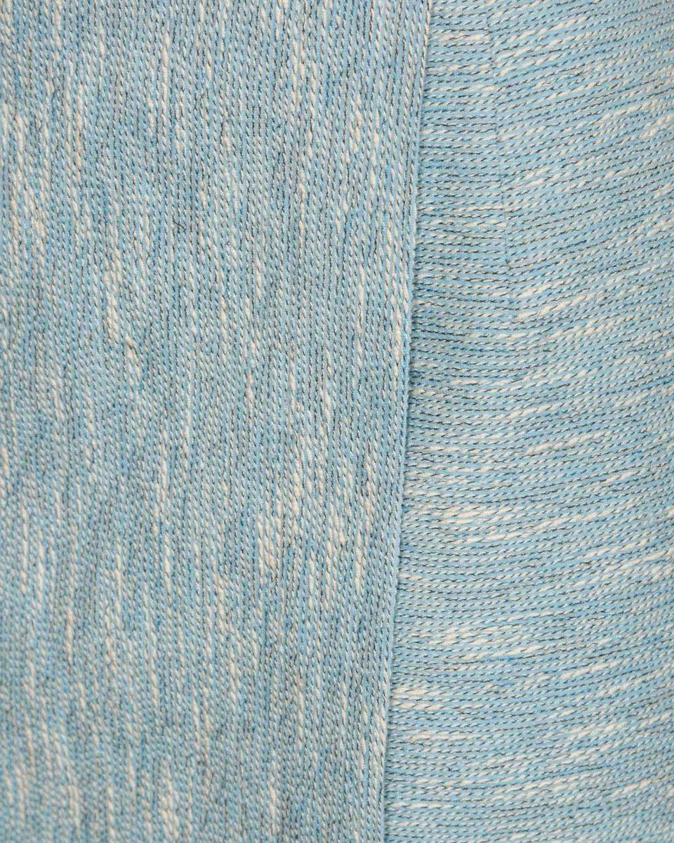 Юбка голубого цвета с асимметричным низом