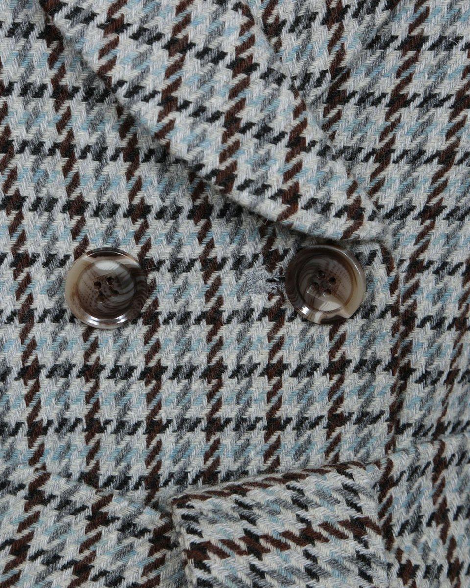 Пальто в гусиную лапку с расклешенной юбкой